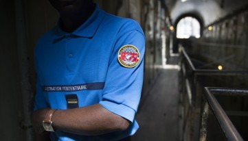 A prison guard poses in the Parisian prison of